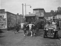 A bullock and cart  holding up traffic in Sidcup , Kent .  1938