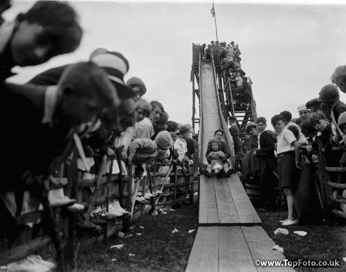 Children on the helter skelter at the fairground for the Abbey Wood fete in London . 1936